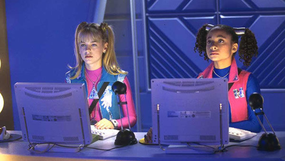 zenon and her friend with some swanky retrofuture computers