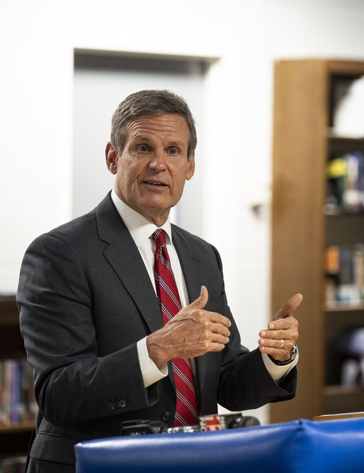 Gov. Bill Lee stands at a podium at Cleveland High School
