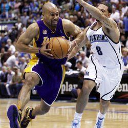 Lakers' Derek Fisher #2 (left) drives on Utah's #8 Deron Williams (right) as the Utah Jazz and the LA Lakers play game 4 in Salt lake City May 11, 2008.