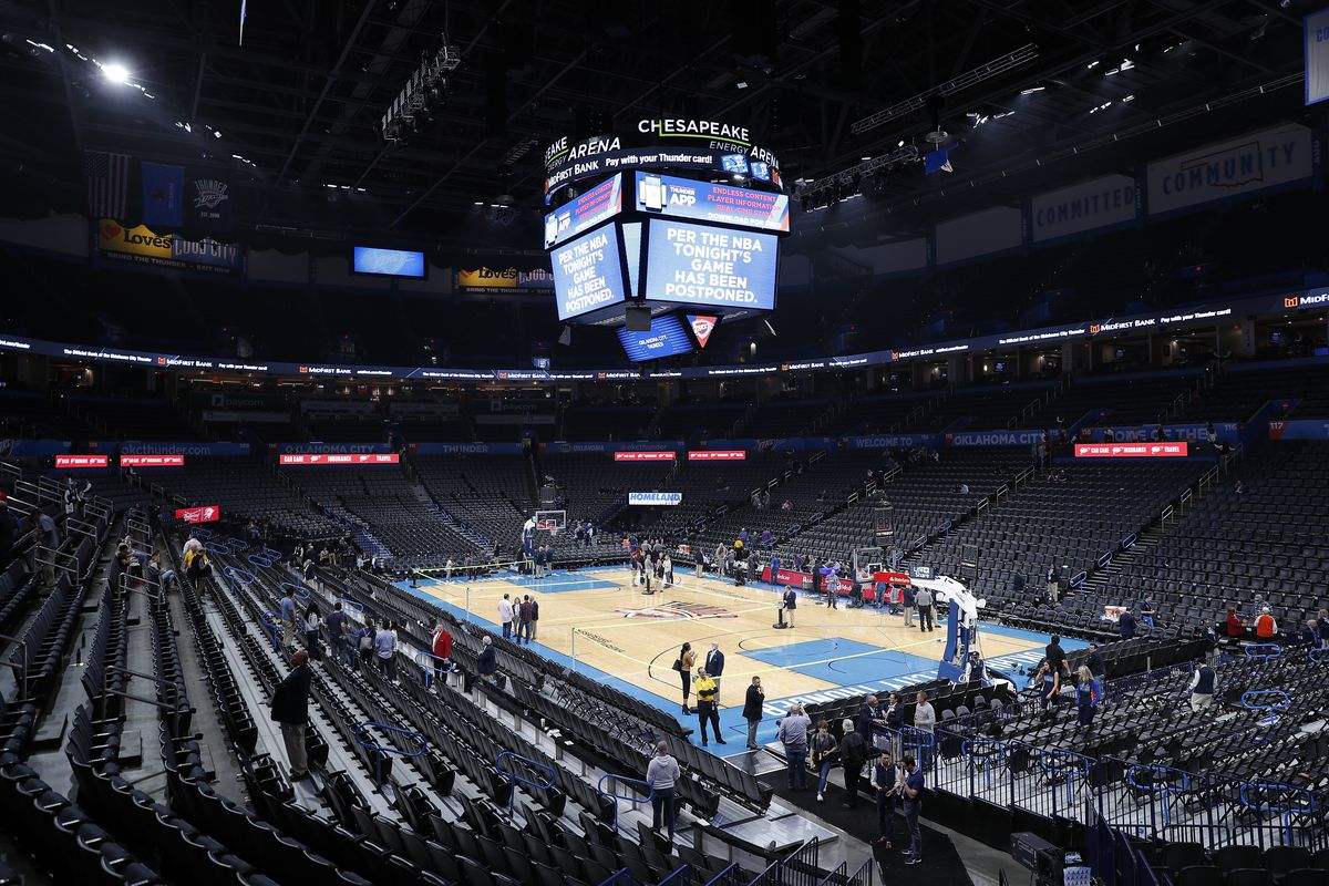 Fan leave after an announcement that the Oklahoma City Thunder vs. Utah Jazz game is canceled just before the tip off at Chesapeake Energy Arena.