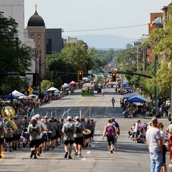 Parade entrants make their way south along 200 East during the Days of '47 Parade in Salt Lake City on Friday, July 23, 2021.