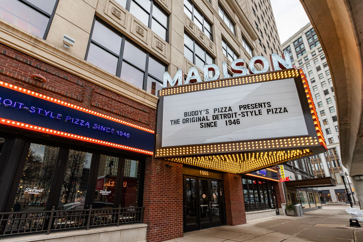 """The marquee at the Madison building reads """"Buddy's Pizza presents the original Detroit-style pizza since 1946 on a cloudy day."""