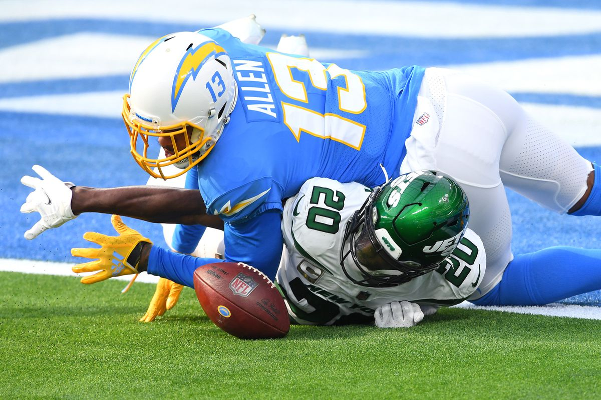 New York Jets free safety Marcus Maye (20) recovers a fumble by Los Angeles Chargers wide receiver Keenan Allen (13) at the goal line in the first quarter at SoFi Stadium.