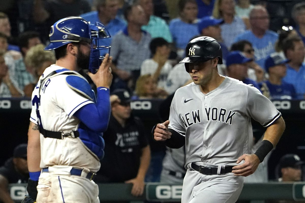 Joey Gallo #13 of the New York Yankees scores against Cam Gallagher #36 of the Kansas City Royals on a Luke Voit single in the seventh inning at Kauffman Stadium on August 09, 2021 in Kansas City, Missouri.