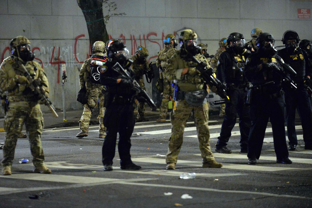 Federal police officers stand guard during a protest in Portland, Oregon, on July 23, 2020. -