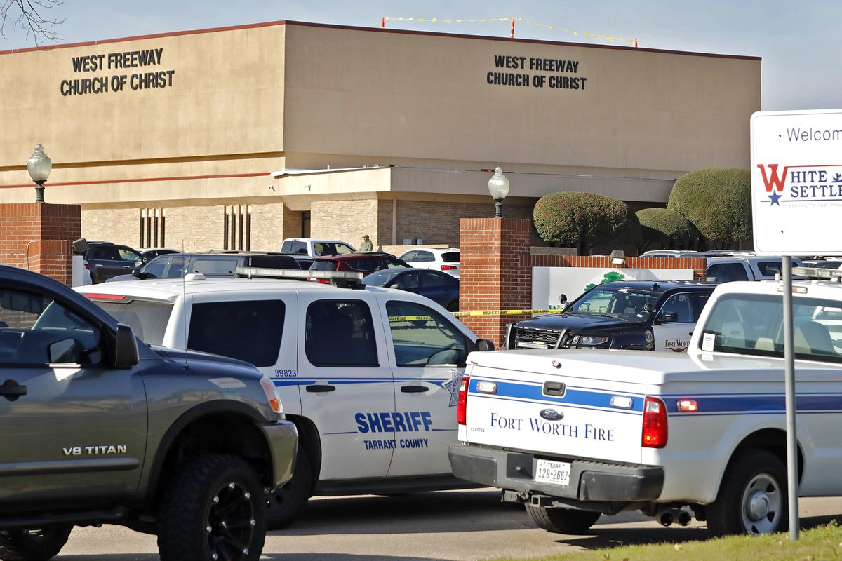 Police vehicles cluster outside a brown brick building — West Freeway Church of Christ.