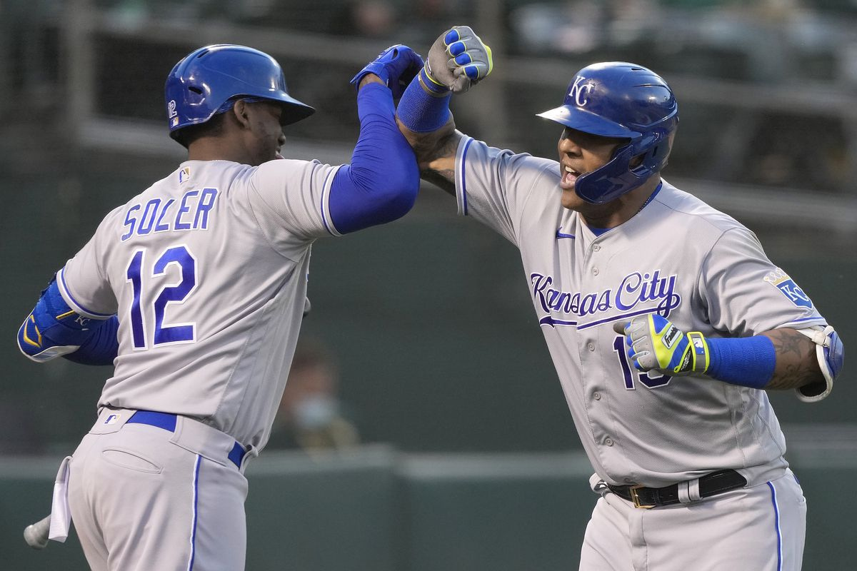 Salvador Perez #13 and Jorge Soler #12 of the Kansas City Royals celebrates after Perez hit a solo home run against the Oakland Athletics in the top of the seventh inning at RingCentral Coliseum on June 11, 2021 in Oakland, California.