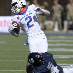 Utah State safety Shaq Bond (4) tackles Boise State wide receiver Khalil Shakir (2) during the second half of an NCAA college football game Saturday, Sept. 25, 2021, in Logan, Utah.