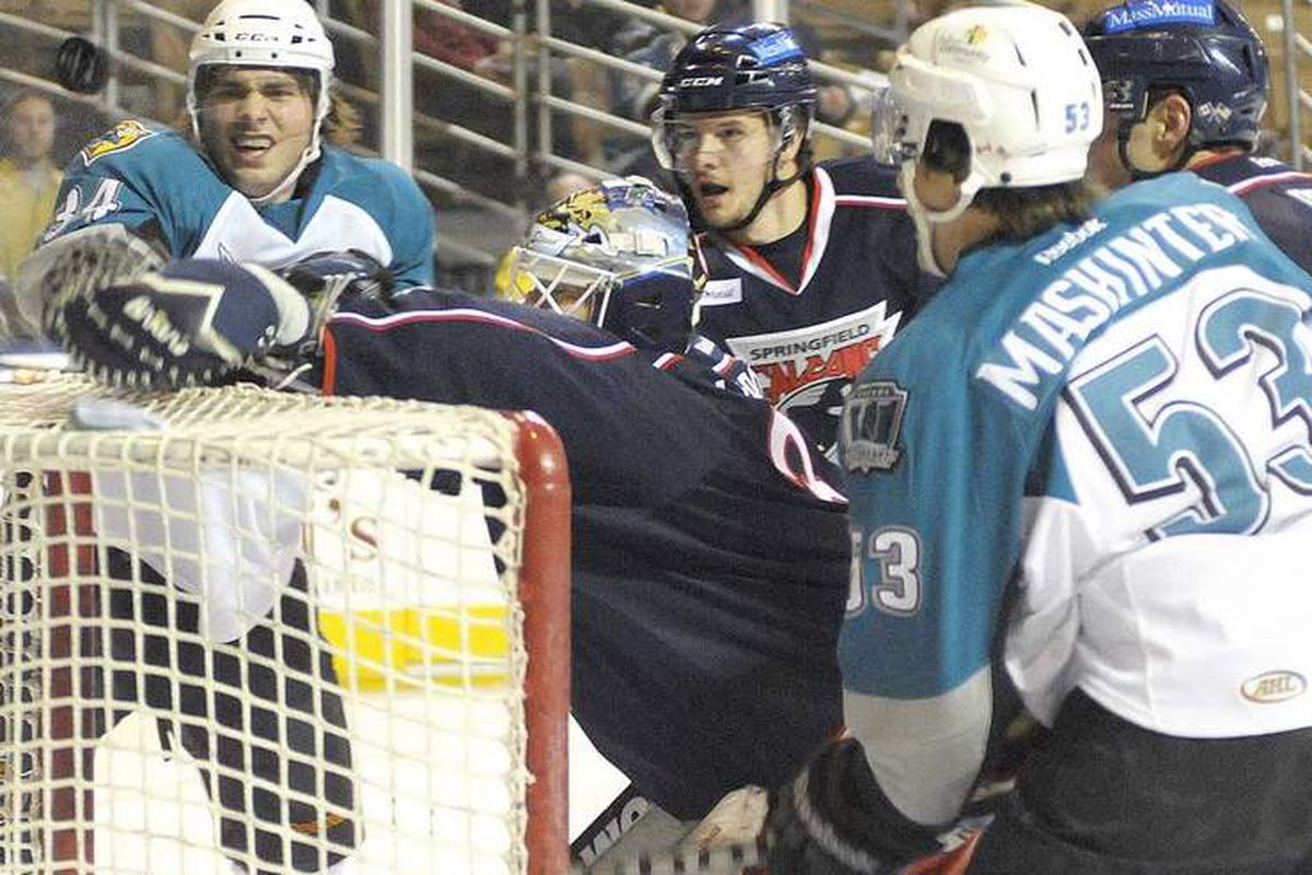 Worcester Sharks forwards Nathan Moon {34} and Brandon Mashinter {53} watch the puck go over the net of Springfield Falcons goalie Manny Legace on Dec. 21. <strong> Photo courtesy of Jim Collins of www.telegram.com</strong>