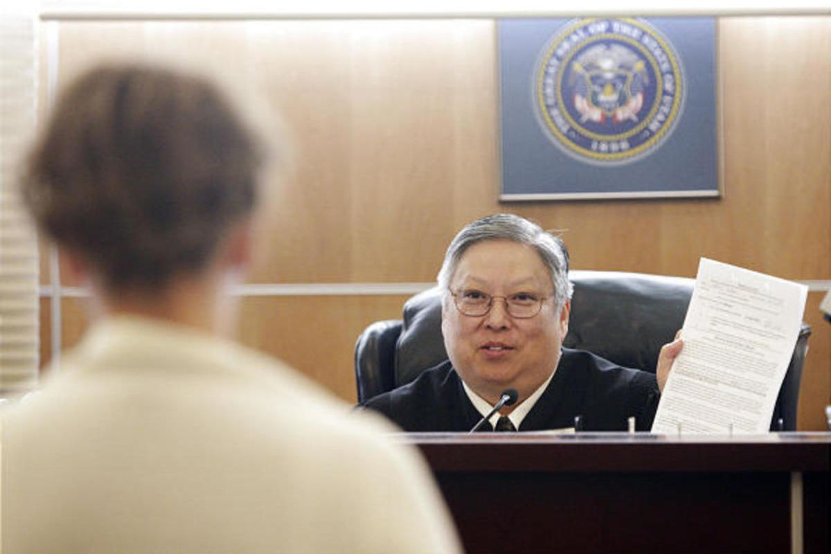 Judge Michael Kwan talks with a defendant during drug court in Taylorsville. Drug courts are small municipal courts.