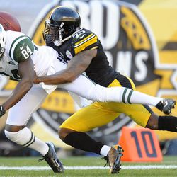 Pittsburgh Steelers free safety Ryan Clark (25) holds on to New York Jets wide receiver Stephen Hill (84) after breaking up a pass in the second quarter of an NFL football game, Sunday, Sept. 16, 2012, in Pittsburgh.