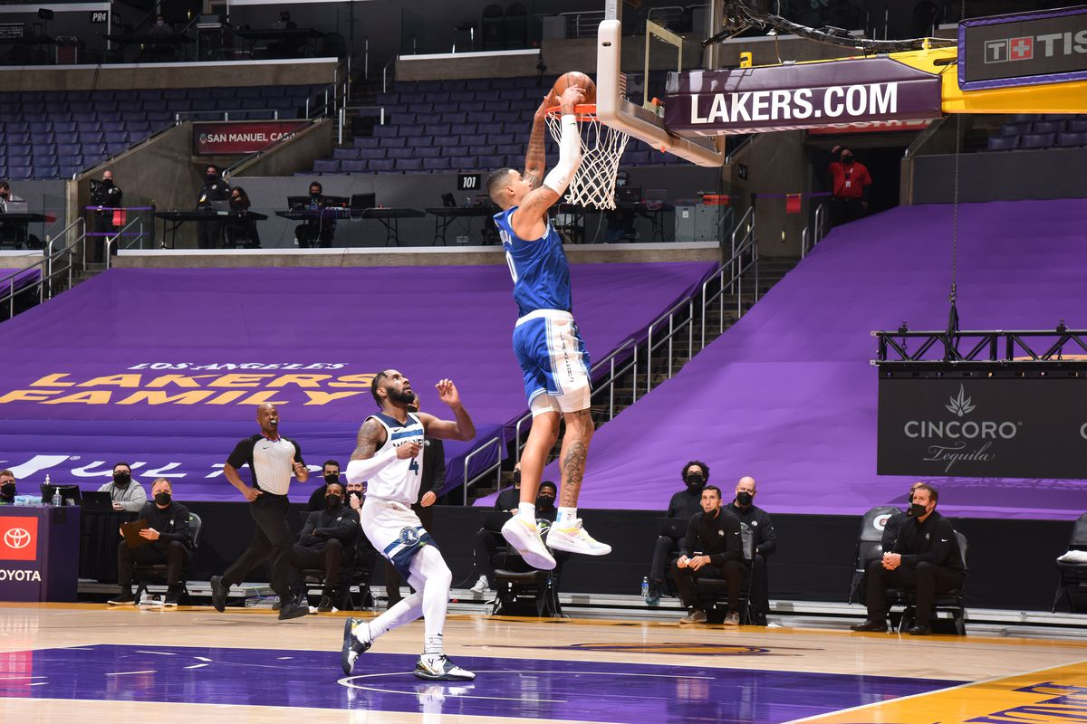 Kyle Kuzma #0 of the Los Angeles Lakers dunks the ball during the game against the Minnesota Timberwolves on March 16, 2021, 2021 at STAPLES Center in Los Angeles, California.