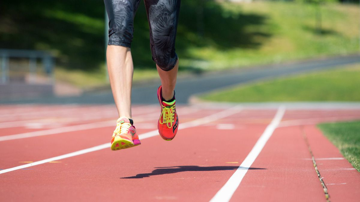 A woman running on a track