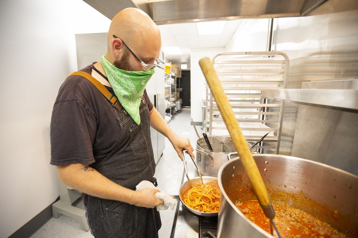 A chef making pasta.