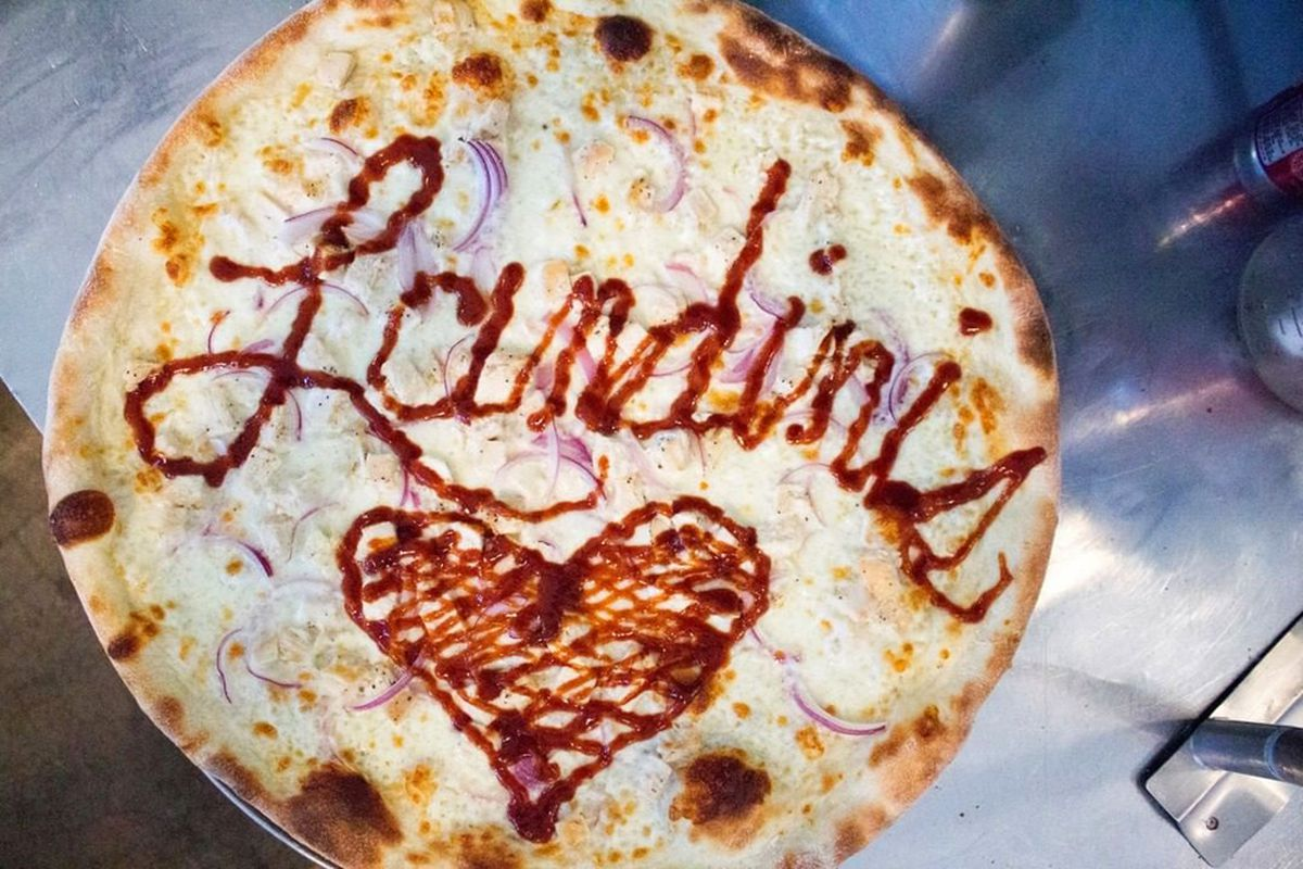 A New York-inspired white pie, decorated in sauce with the name of Landini's Pizzeria, coming soon to the southwest.