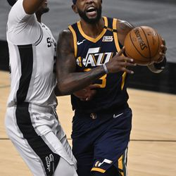 Utah Jazz's Royce O'Neale, right, drives against San Antonio Spurs' Rudy Gay during the first half of an NBA basketball game, Sunday, Jan. 3, 2021, in San Antonio.