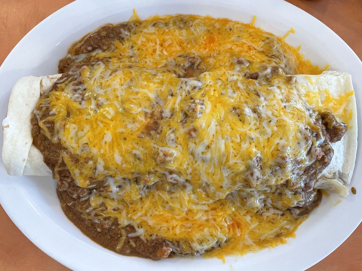 Burrito smothered with bean chili and cheese