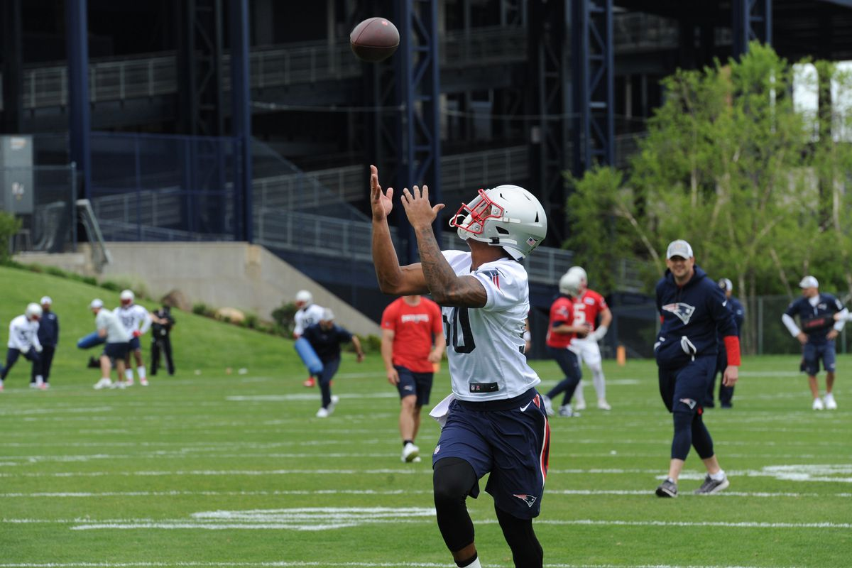 New England Patriots wide receiver N'Keal Harry catches a pass during organized team activities at Gillette Stadium practice field.