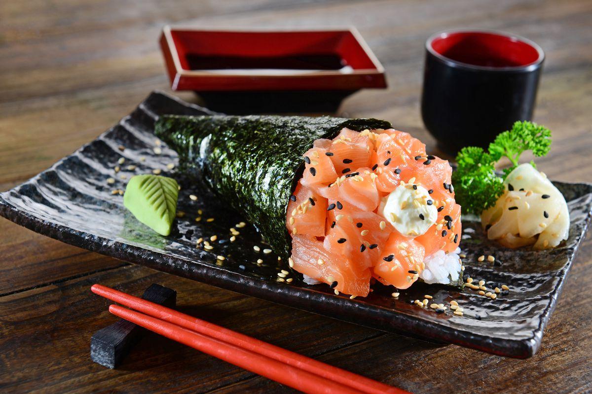 A salmon hand roll