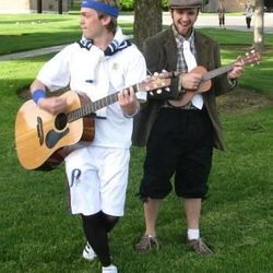 Wandering troubadours, from left, Kyle Oram and Nick Grossaint, invite park visitors to the free show.