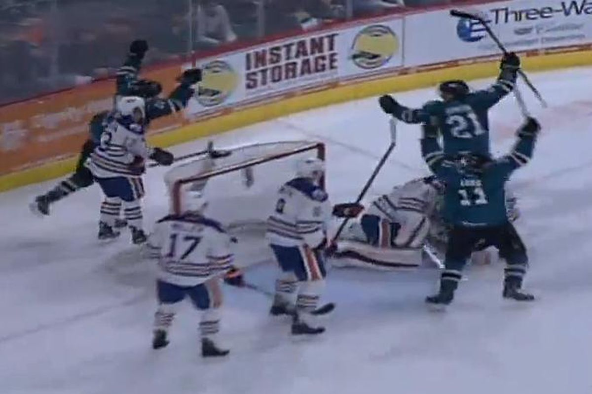 The San Jose Barracuda line of Bryan Lerg, John McCarthy and Ben Smith celebrate Smith's late third period goal, which held up as the game winner Friday night in Bakersfield. (AHL Live)