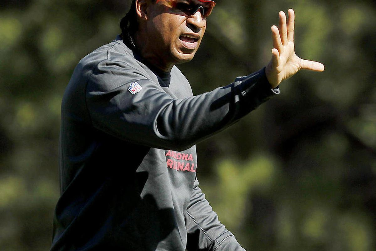 FILE - This July 26, 2012 file photo shows Arizona Cardinals defensive coordinator Ray Horton working with his defense during at Northern Arizona University in Flagstaff, Ariz. In Horton's second season as Arizona's defensive coordinator, the Cardinals ar