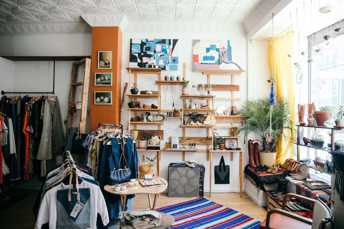 A shop's interior with vintage clothes and local jewelry.