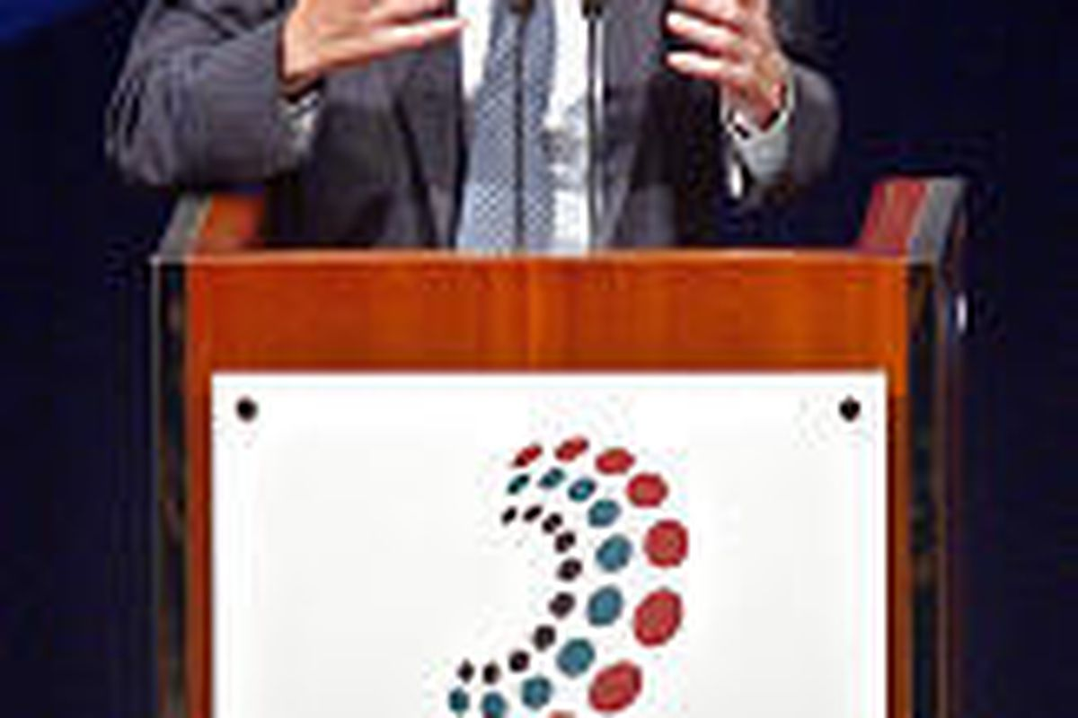 U.S. Treasury Secretary John W. Snow speaks at opening ceremony of '03 meeting of International Monetary Fund and World Bank in Dubai, United Arab Emirates, Tuesday. Both groups have expressed concerns about U.S. deficit.