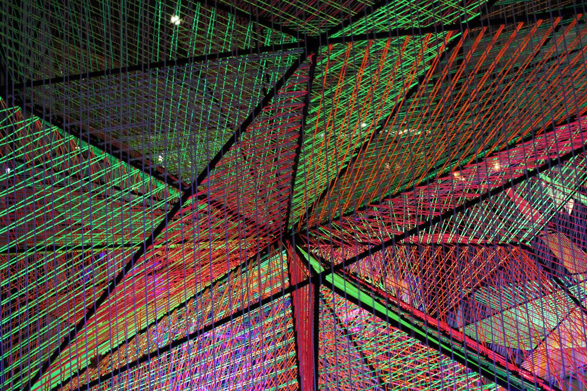 A light display with red and green threads in a mesh structure.