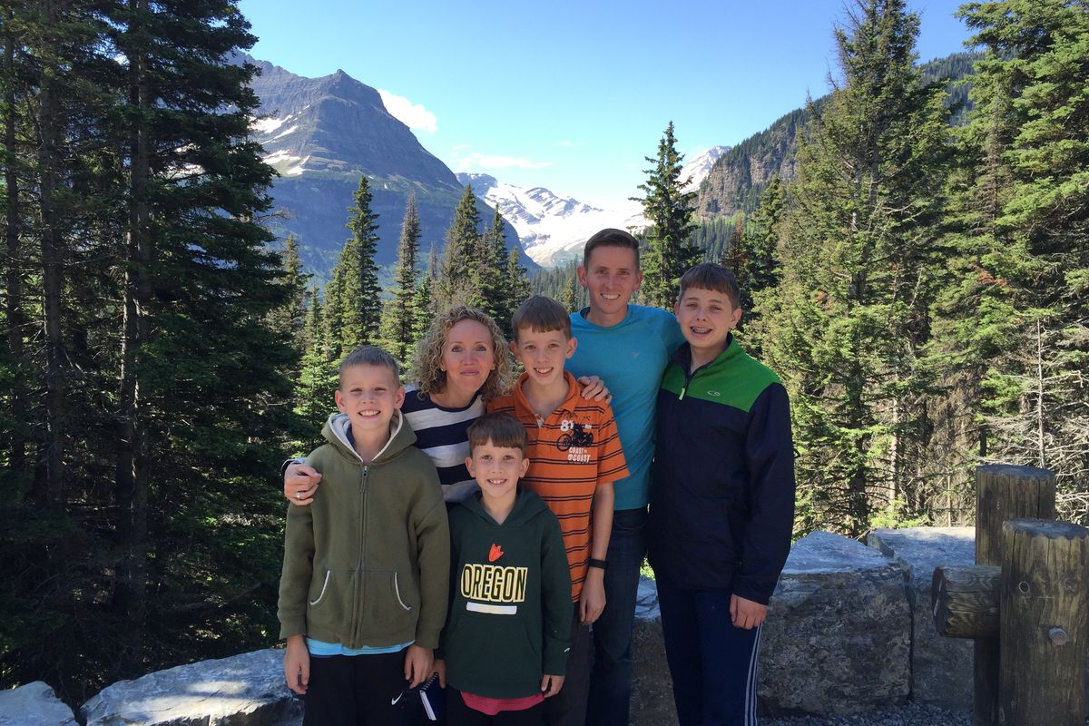 The Lewis family hikes through Glacier National Park on one of their family road trips. The great American road trip is more popular than ever.