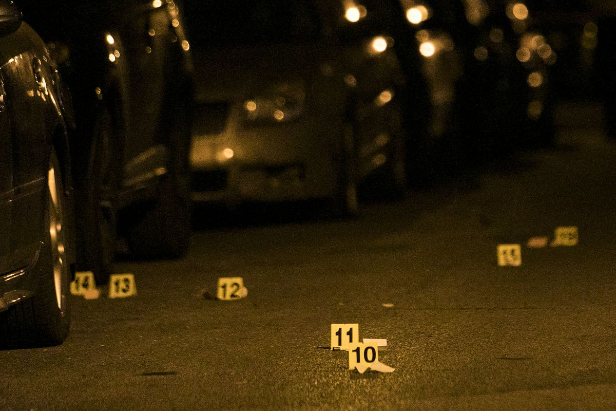 Chicago Police investigate in the 3000 block of West 60th Street, where a 26-year-old man was shot to death early Monday, Aug. 14, 2017. | Ashlee Rezin/Sun-Times