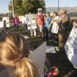 People hold signs during a rally asking Utah Gov. Gary Herbert to shut down Stericycle's medical waste incinerator in North Salt Lake on Thursday, Sept. 25, 2014.