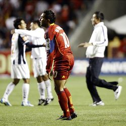 Arturo Alvarez of Real Salt Lake reacts to losing to the Rayados of Monterrey, celebrating in the background, after the final game of the CONCACAF championship at Rio Tinto Stadium in Sandy Wednesday, April 27, 2011.