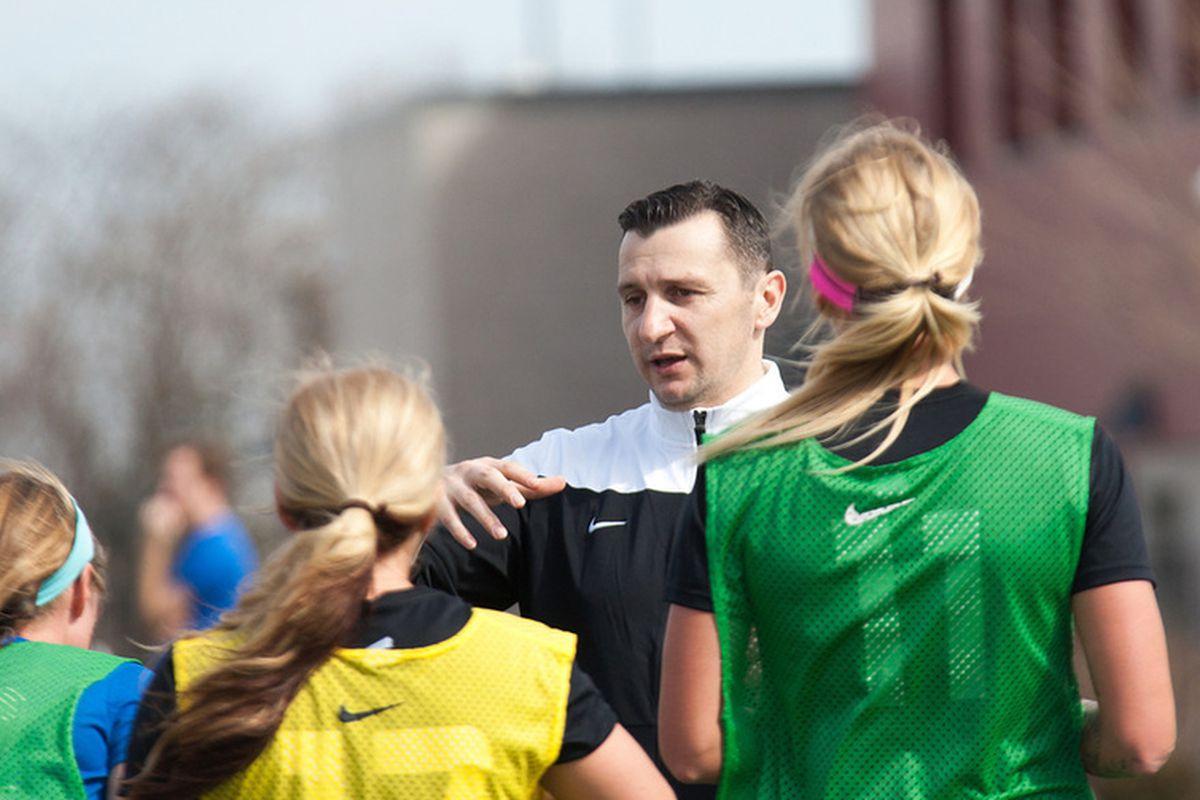 Blues head coach Vlatko Andonovski talking to players