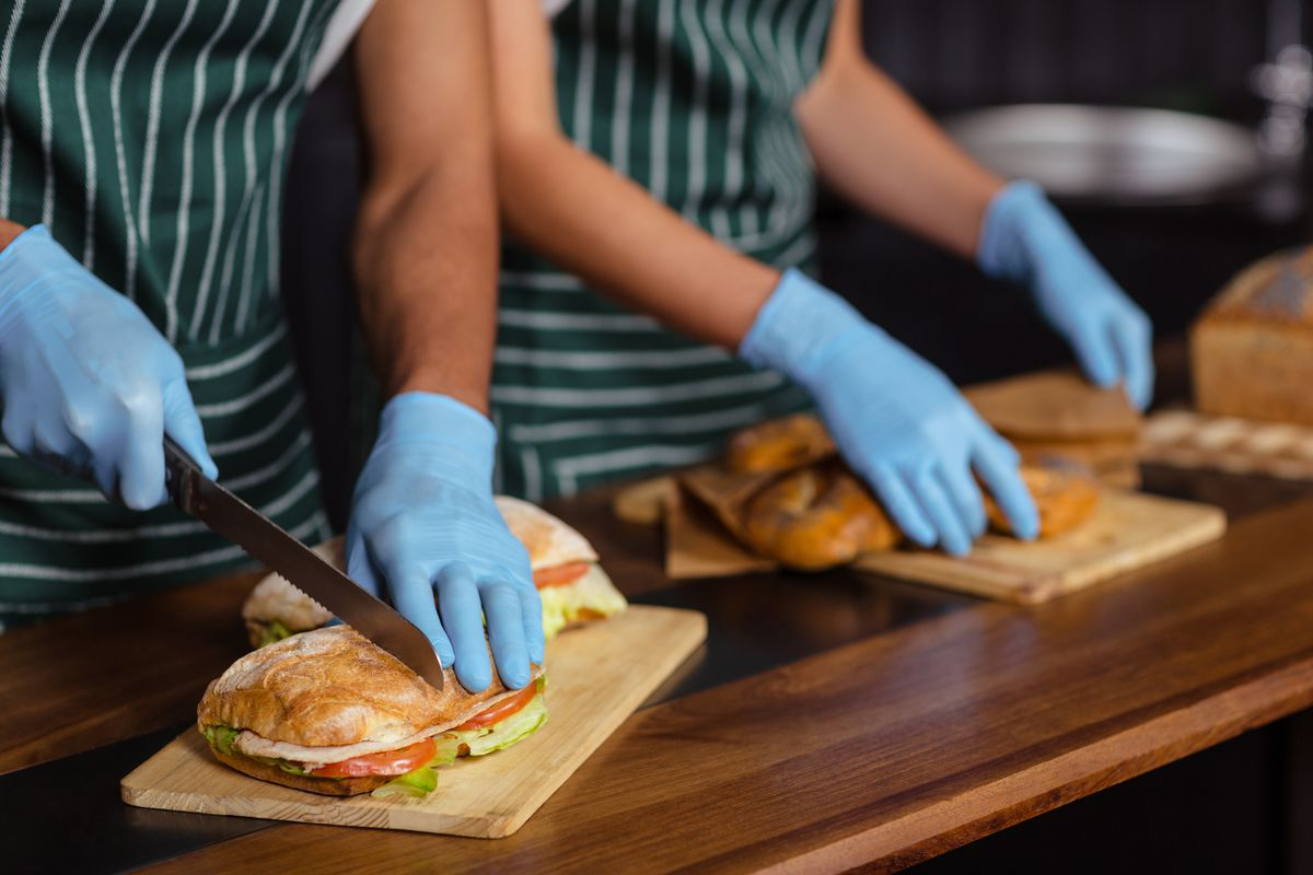 Workers making sandwiches
