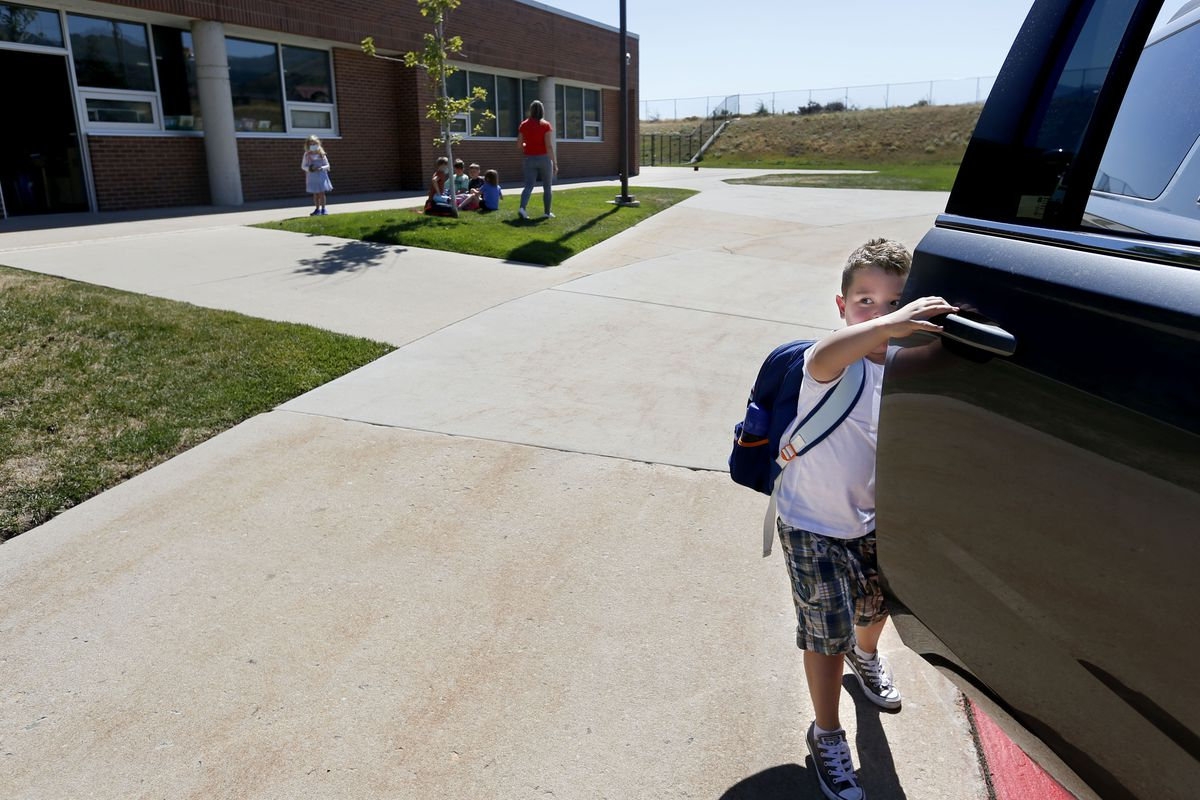 Dominic Francese gets into his mother's car after school at Jeremy Ranch Elementary School in Park City on Friday, Sept. 4, 2020. Parents have been asked to remain in their cars during pickup and drop-off at school. Francese's mother, Laura, would like the ability to get general COVID information about cases or outbreaks in schools. Currently there is no comprehensive information, although the state is working on a dashboard.