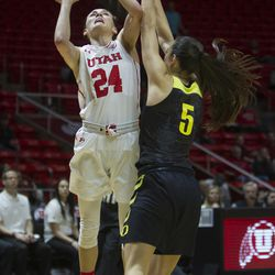 Utah Utes wing Tilar Clark (24) puts up a shot while guarded by Oregon Ducks guard Maite Cazorla (5) during the teams' matchup at the Jon M. Huntsman Center in Salt Lake City on Sunday, Jan. 28, 2018.