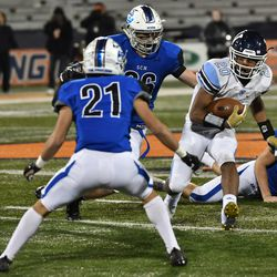 Nazareth's Michael Love (20) shakes off St. Charles North. Worsom Robinson/For the Sun-Times.