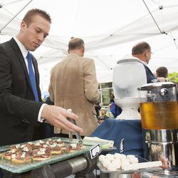 Travis Talbot, an engineering student at BYU, samples the snacks following the groundbreaking ceremony for a new engineering building at BYU in Provo on Monday, May 9, 2016. The new building was entirely funded by donors.
