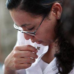 Esmerelda Zuazo prays during a vigil for immigration reform in Salt Lake City, Thursday, June 27, 2013.