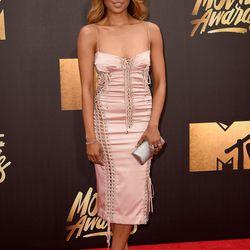 Kat Graham wears a pink Dolce & Gabbana dress.