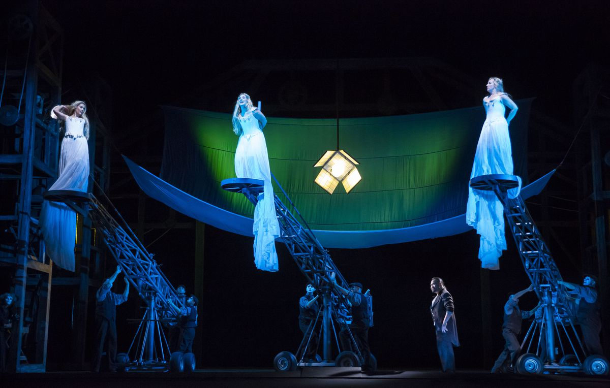 """The Rhinemaidens arrive on cranes in the new Lyric Opera of Chicago production of Richard Wagner's """"Das Rheingold."""" (Todd Rosenberg Photography)"""