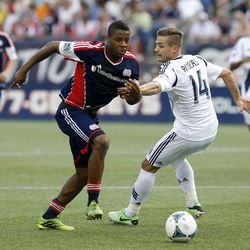 New England Revolution defender Andrew Farrell (2) works the ball against Los Angeles Galaxy Robbie Rogers (14).