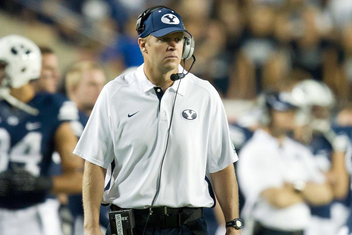 Bronco Mendenhall looks over his team on the field