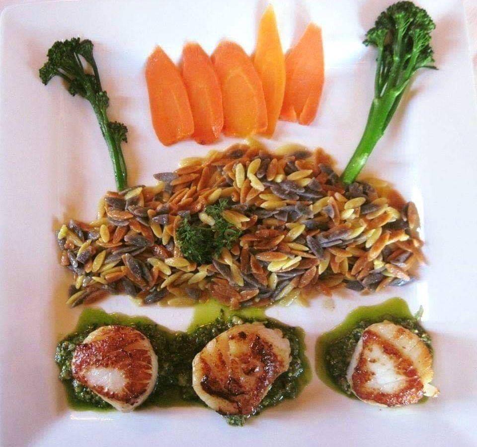 An artfully presented seared sea scallops