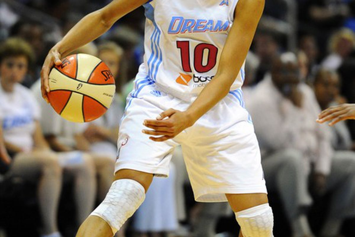 June 17, 2012; Atlanta, GA, USA; Atlanta Dream guard Lindsey Harding (10) handles the ball against the Connecticut Sun during the second half at Philips Arena. The Sun defeated the Dream 75-73. Mandatory Credit: Dale Zanine-US PRESSWIRE