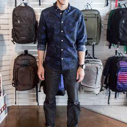 "<b>Greg Bass – Director of Product and Design</b> is wearing Global Work shirt, a Timbuk2 t-shirt, Banana Republic jeans, Clarks Originals Desert Boots, Nixon watch, and a Carhartt belt. <br> <b>What fashion rule do you shamelessly break?</b>    ""It i"