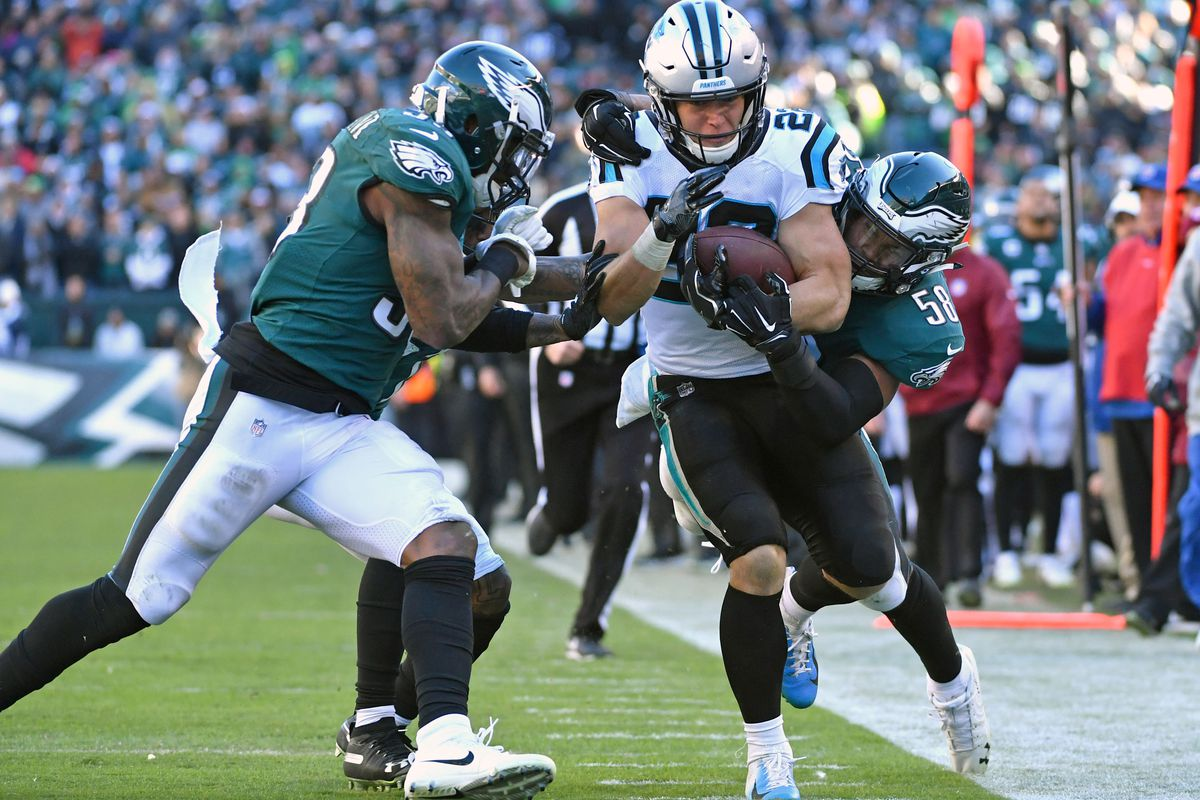 Panthers running back Christian McCaffrey (22) is stopped short of the goal one by Philadelphia Eagles linebacker Nigel Bradham (53) and linebacker Jordan Hicks (58) during the fourth quarter at Lincoln Financial Field.