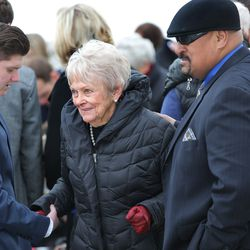 Patti Edwards talks with Tom Sitake father of BYU head football coach Kalani Sitake as family, friends gather at East lawn Memorial Hills Cemetery in Provo for graveside services for former BYU football coach LaVell Edwards on Saturday, Jan. 7, 2017.