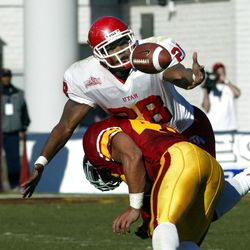 Utah running back  and MVP Dameon Hunter reaches for a loose ball over USC's MVP Troy Polamalu  as  Utah beat USC 10-7 in the Las Vegas Bowl on Dec. 25, 2001. Photo by Tom Smart